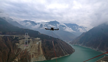 UAV Stretches Cable Across Dadu River For Bridge In Ya'an